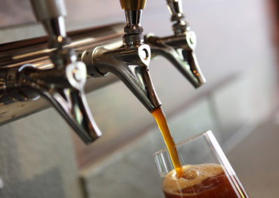 Pouring beer from a tap